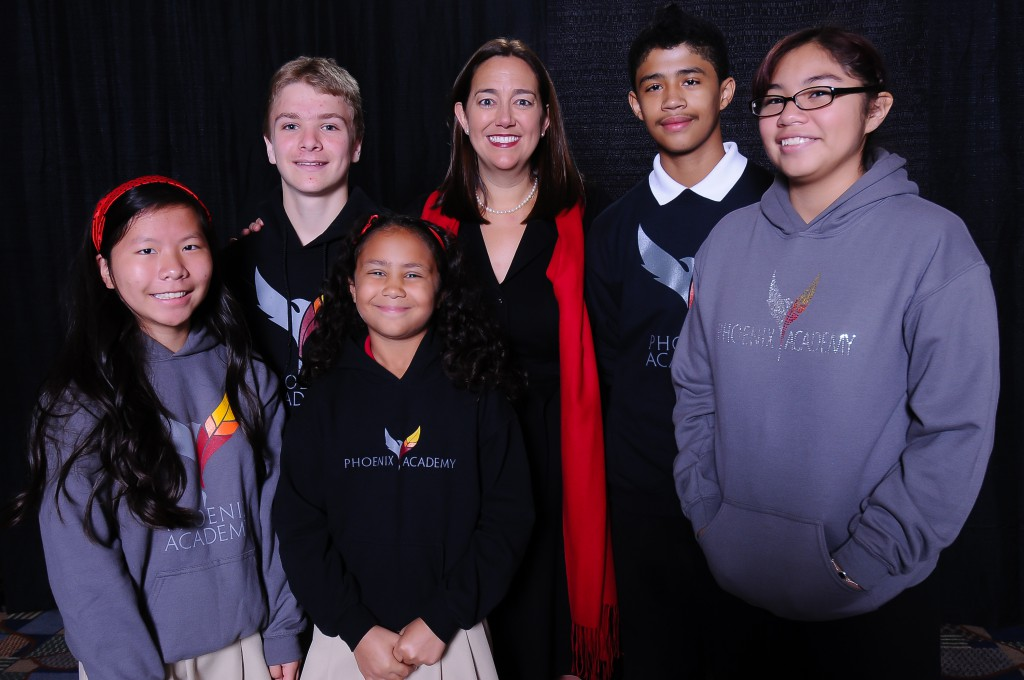 Erin Gruwell poses with Phoenix Academy Students