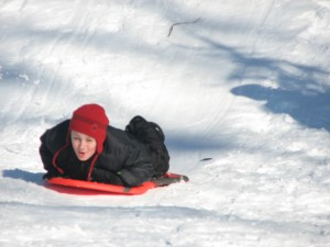Phoenix Academy students sled during recess.